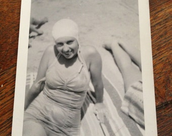 woman in bathing cap and one piece suit on the beach antique photo