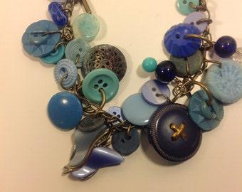 A Baby Blue Vintage Button Charm Bracelet