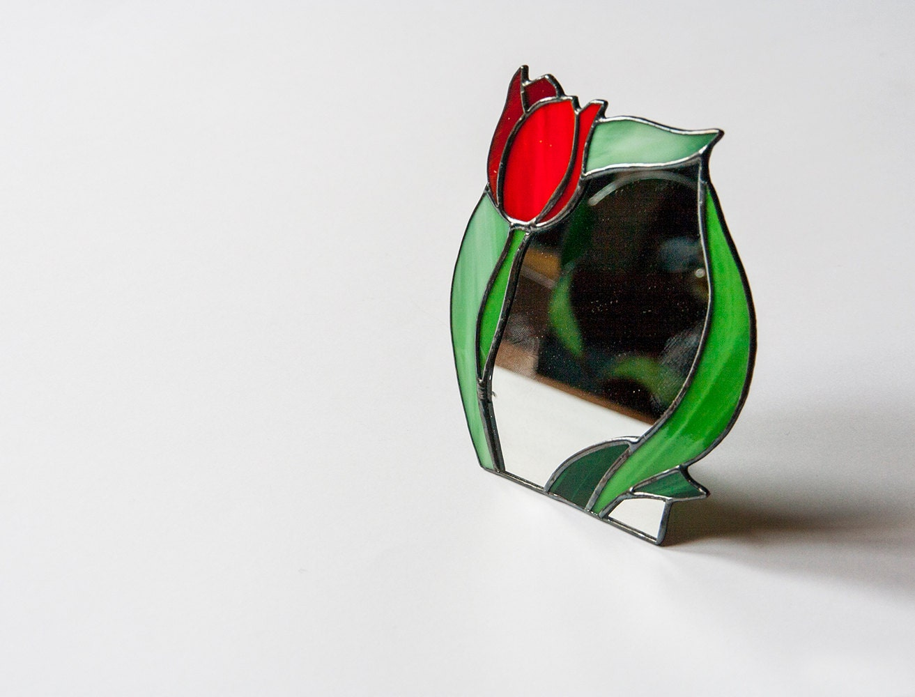 Standing mirror with stained glass frame tulip by for Standing glass mirror