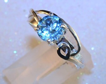 Floating - Blue Topaz gemstone ring