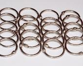 Twenty loose leaf book binder rings