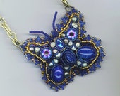 Embroidered Butterfly Pendant . Glass Eye butterfly . German Glass, Real Pearls - Indigo Blue Primitive Butterfly by enchantedbeads on Etsy