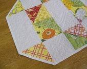 table topper in bright spring colors patchwork design and decorative quilting