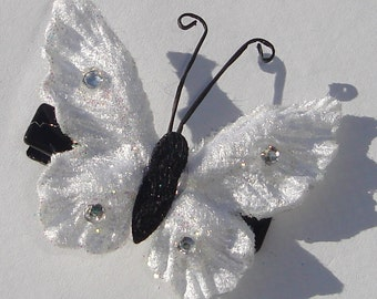 small embossed white velvet butterfly hair clip with rhinestone details and antennae