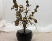 Vintage brass and wood flowers