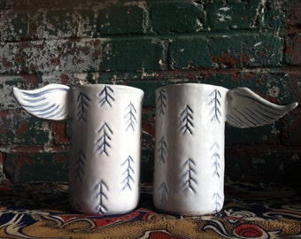 A Pair of Winged Porcelain Tumblers or Cups