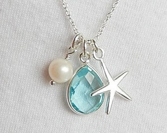 Sterling silver starfish  charm necklace with  blue topaz teardrop charm and freshwater pearl. bridal jewelry,beach wedding, december