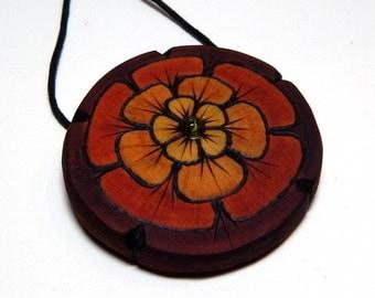 Tribal Red Marigold Kadifa Round Magnolia Wood Pendant with Peridot Green Glass Bead Necklace on Hemp by Tanja Sova