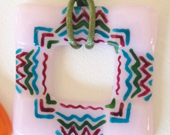 Pink Fused Glass Hand Painted in an Aztec Design on Nylon Cord