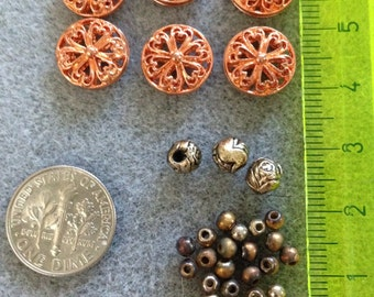 Copper-colored metal beads plus others F2