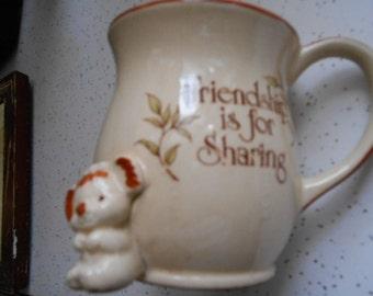 Vintage Pottery mug reads Friendship is for sharing little koala bear figure on front