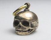 embryo skull small bronze