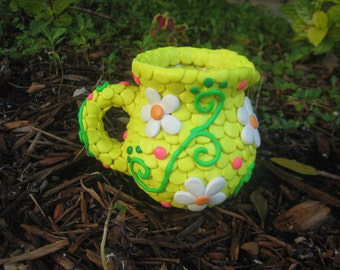 Clay-Covered Pitcher with Flowers and Swirls