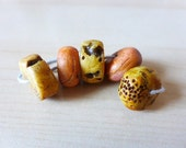 Faux Ancients in Ivory/Amber/Bone. Polymer clay artisan wheel beads.