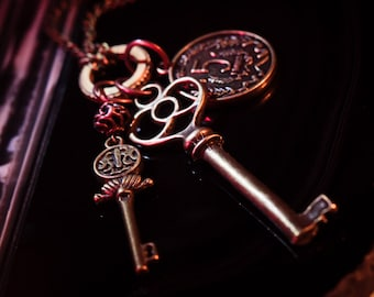 Antique Bronze Keys and Coins Necklace