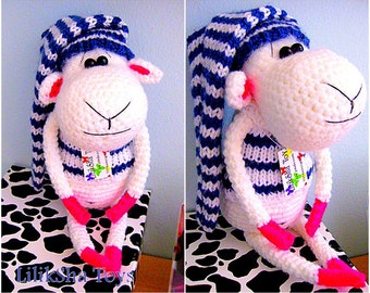 Crochet toy Amigurumi Pattern - Moo the Sheep in a sweater and a cap.