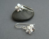 tiny silver flower earrings. small plumeria earrings. sterling dangle. floral botanical nature gardener. drop earrings. simple jewelry gift