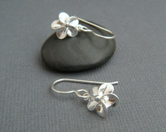 tiny silver flower earrings. small plumeria earrings. sterling dangle. floral botanical nature gardener. drop earrings. simple jewelry gift