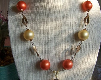 Vintage chunky orange pearls necklace with gold metal accents and yellow balls
