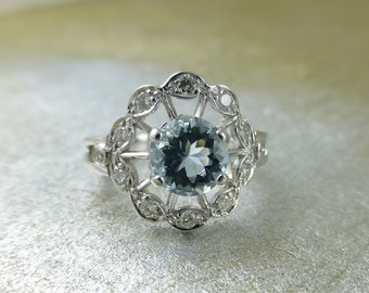 Floral engagement ring.  Aquamarine ring.  Diamond ring.