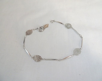 Delicate silver tone link bracelet by Sarah Coventry