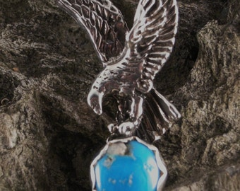 PENDANT STERLING SILVER,  Flying Eagle Sterling Silver, approx 10 mm Turquoise Cabochon, Pendent is 35 mm high and 19mm wide.