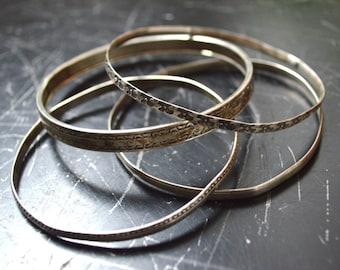 4 Vintage 1970s hand hammered sterling silver bangle bracelets