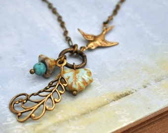 FIRST SIGN of SPRING antiqued brass necklace with sparrow and  glass leaf beads