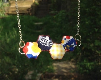 Tiny patchwork hexagon necklace in red, yellow and blue