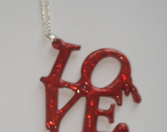 Red glitter bleeding Love word necklace