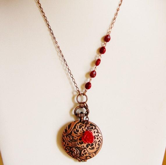 Lady bug, flower and filigree locket on copper