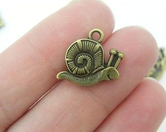 10 Snail charms antique bronze tone BC26