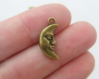 10 Moon charms antique bronze tone BC123