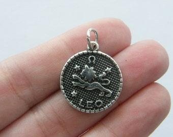 2 Leo pendants antique silver tone M387
