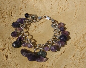 Sterling Silver and Amethyst Charm Bracelet featuring a hand carved Amethyst Winged Heart And sterling silver heart charms!