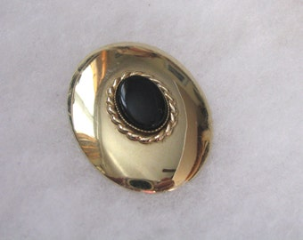 Oval vintage gold tone brooch pin with black cab center.  ROMA by Sarah Coventry