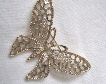 Splendid Madame Butterfly open design gold tone brooch pin by Sarah Coventry