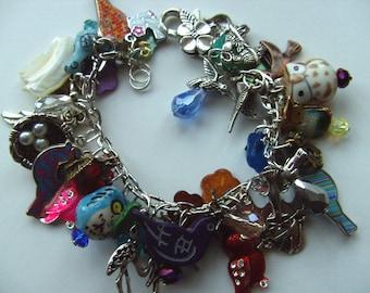 Birds, charm bracelet, loaded bracelet, bird watcher, bird bracelet, nest, feather, owl, by NewellsJewels on etsy