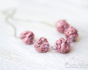 Pale pink necklace with fabric beads