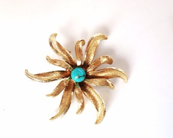 Vintage flower brooch gold flower turquoise center pin brooch in a gold tone