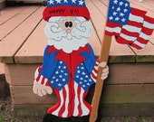Handmade wooden custom painted Uncle Sam with a flag for your patriotic holiday decorations