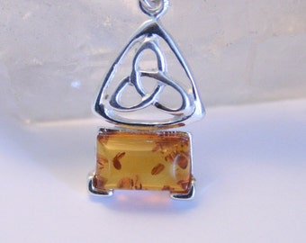 Amber and sterling silver pendant. Celtic. Sterling chain