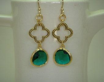 Green glass dangle earrings on clover link