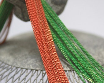 The shiny green and orange chains