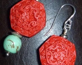 Floral cinnabar earrings with turquoise color stone beads