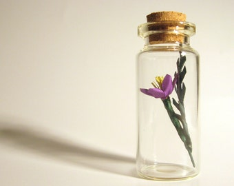 paper flower sculpture in glass jar tiny handmade purple botanical specimen