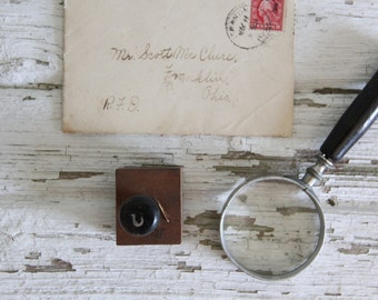 vintage letterpress hand stamp ink print block alphabet letter U
