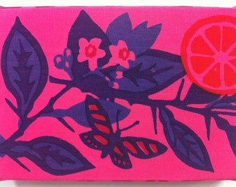 Vintage fabric wall hanging with butterfly and foliage print in pink and purple