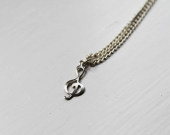 tiny treble clef -necklace (tiny silver tone treble clef charm on a silver plated chain)