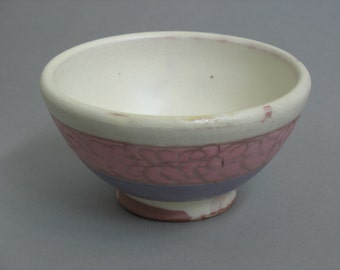 Lowfire earthenware bowl with sheep motif.